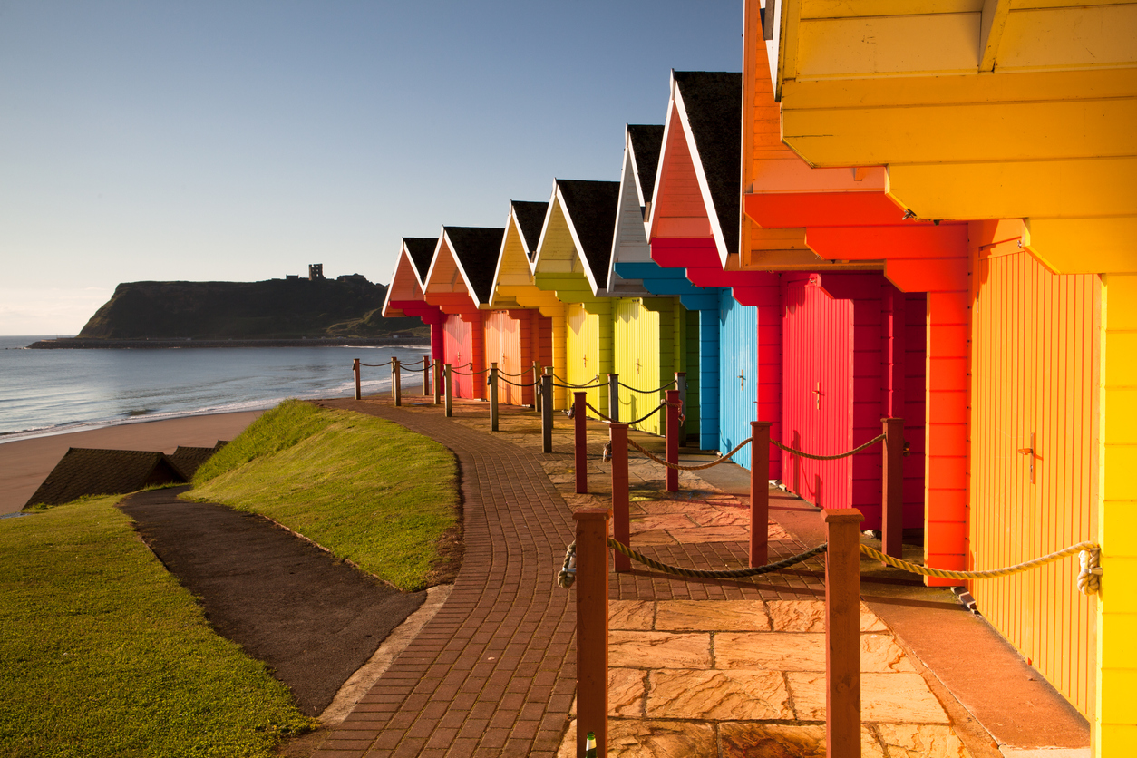 Colorful beach huts near ocean